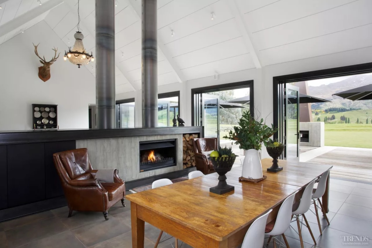 A long, low wall framed in blackened steel house, interior design, living room, property, real estate, gray