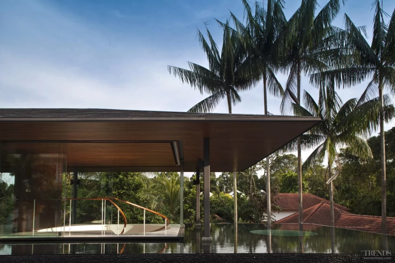 The living pavilion resembles a floating platform. Glass architecture, arecales, building, eco hotel, estate, facade, home, house, leisure, palm tree, property, real estate, resort, roof, shade, tree, vacation, villa, black