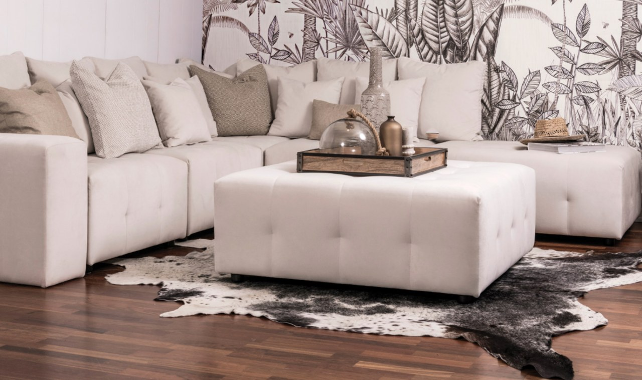 Furniture that is in constant use needs a beige, chair, coffee table, couch, floor, flooring, furniture, interior design, laminate flooring, leather, living room, ottoman, room, sofa bed, table, wall, wood flooring, gray