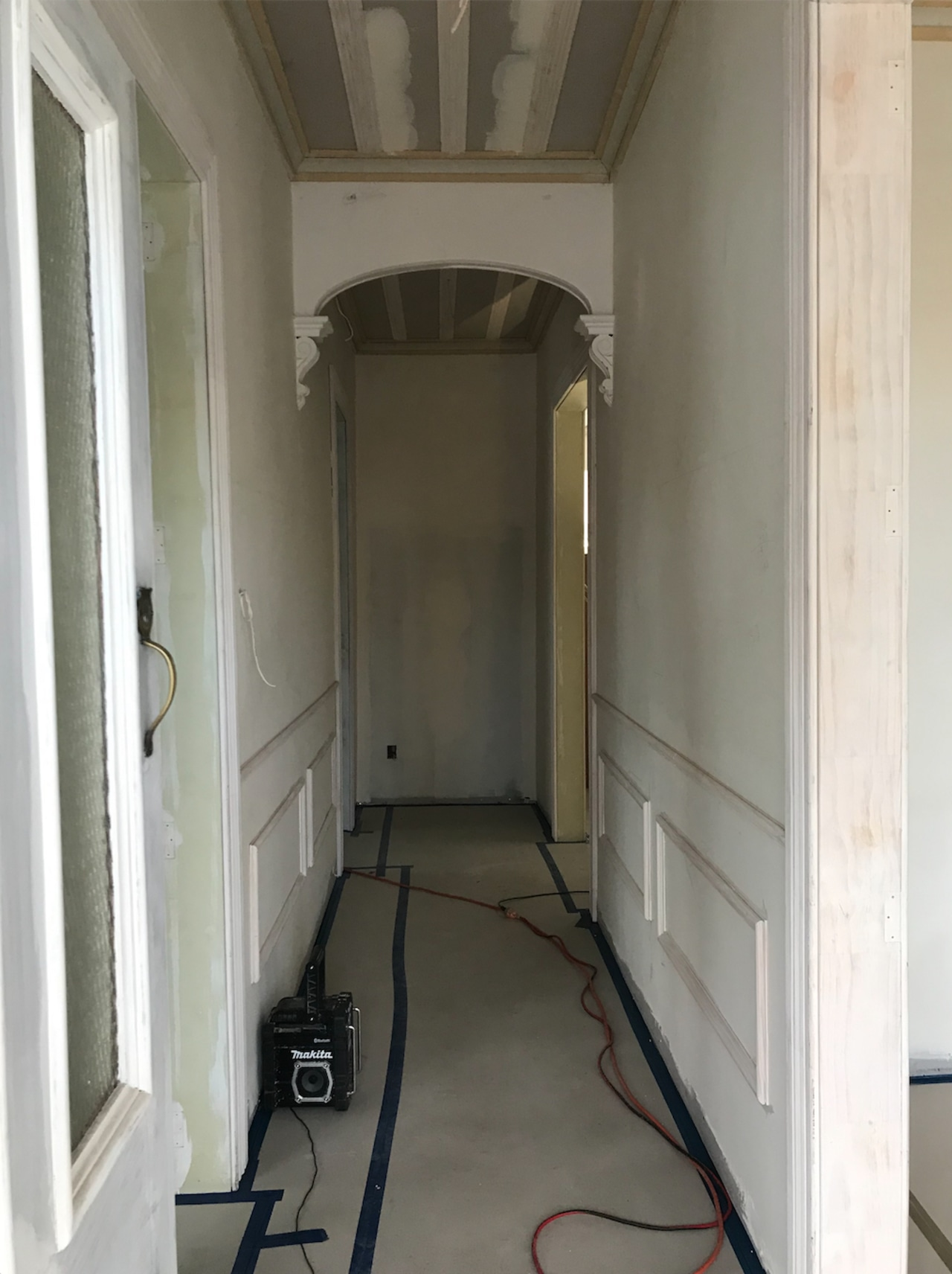 The hallway panelling has now been completed. architecture, building, ceiling, floor, hall, house, plaster, property, room, wall, gray