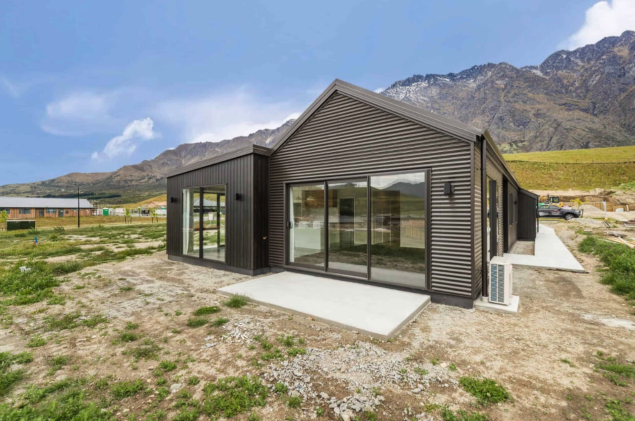 The dark-toned home seems to echo the rugged