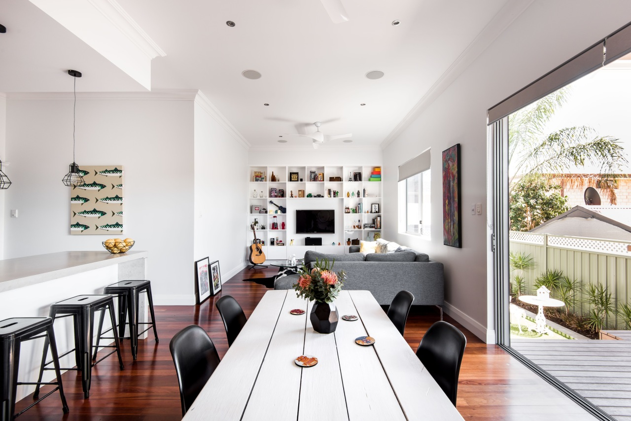 White walls and ceilings ensure the living spaces architecture, building, ceiling, design, dining room, floor, flooring, furniture, home, house, interior design, living room, property, real estate, room, table, wall, white, wood flooring, white