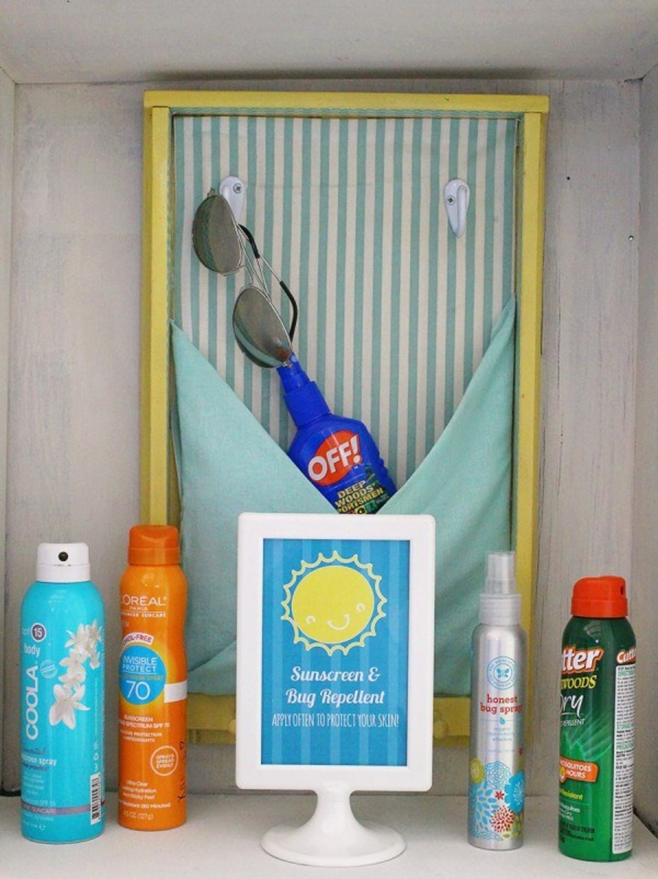 A sunblock and bug spray station product, shelf, gray