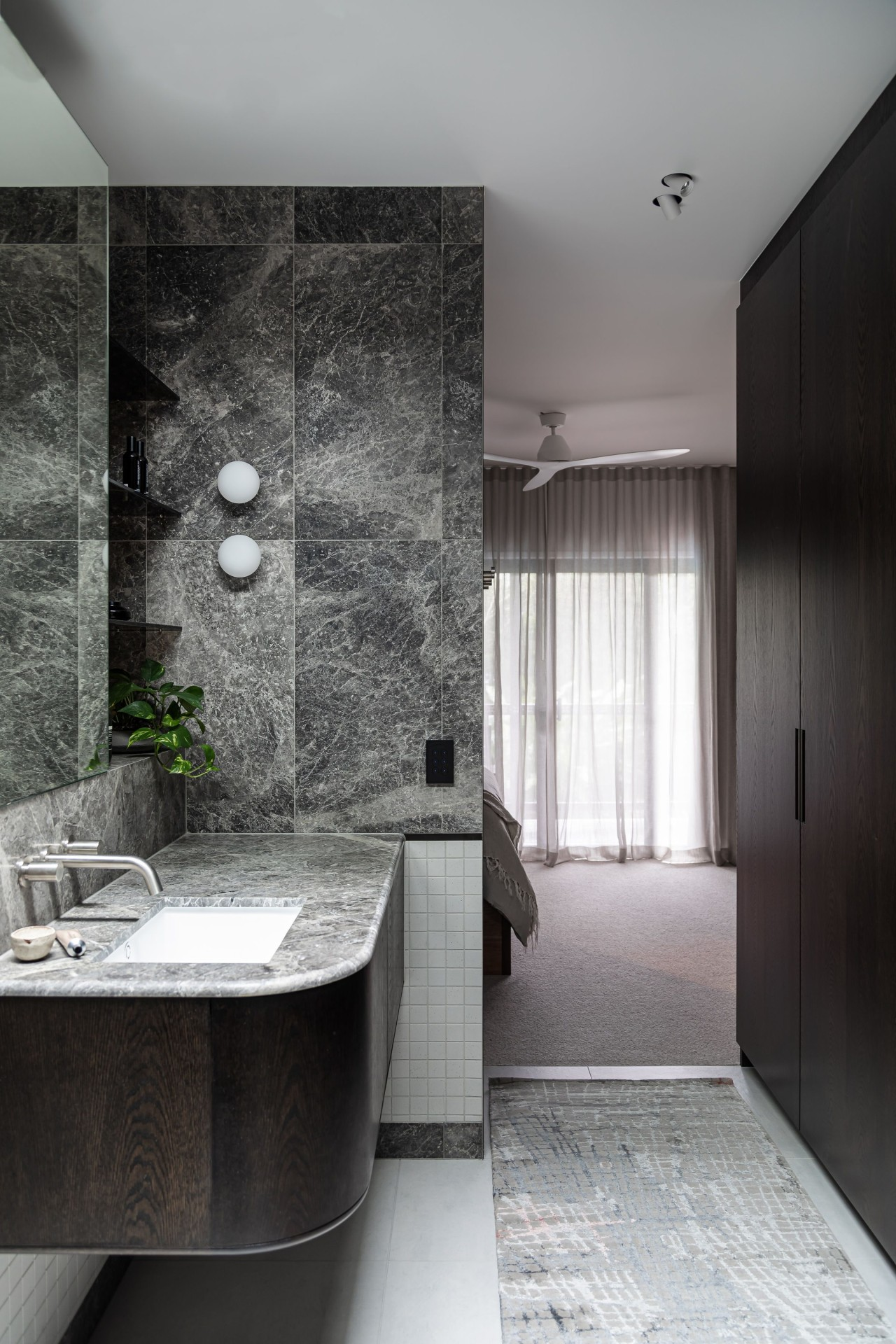The staggered design layout allows the bathroom to