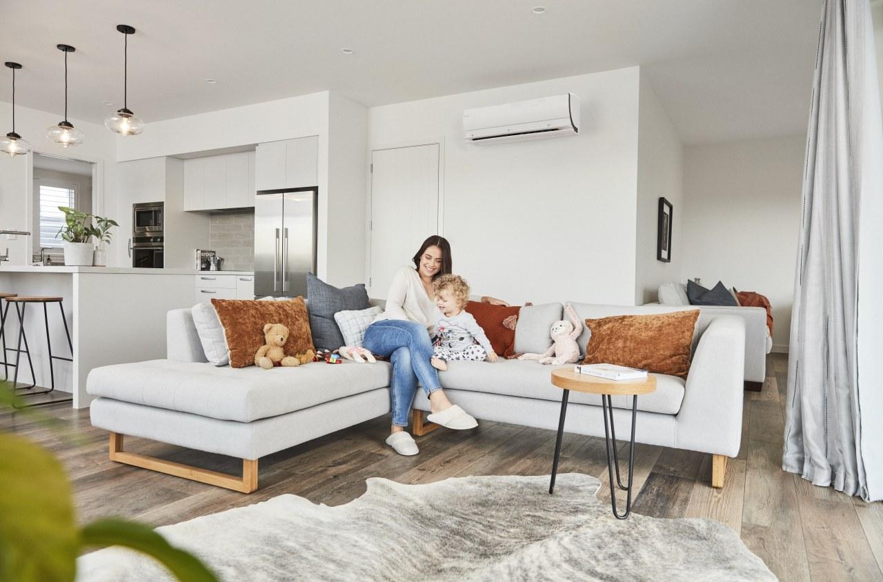Daikin - couch | floor | flooring | couch, floor, flooring, furniture, home, interior design, living room, room, table, window, gray, white
