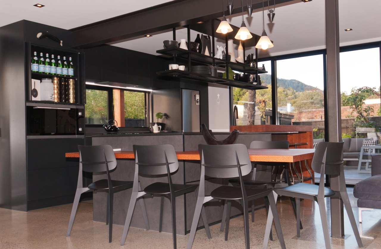 All internal walls were removed, from the lower bar stool, building, café, cafeteria, ceiling, dining room, door, floor, flooring, furniture, home, house, interior design, kitchen & dining room table, property, real estate, restaurant, room, stool, table, gray, black
