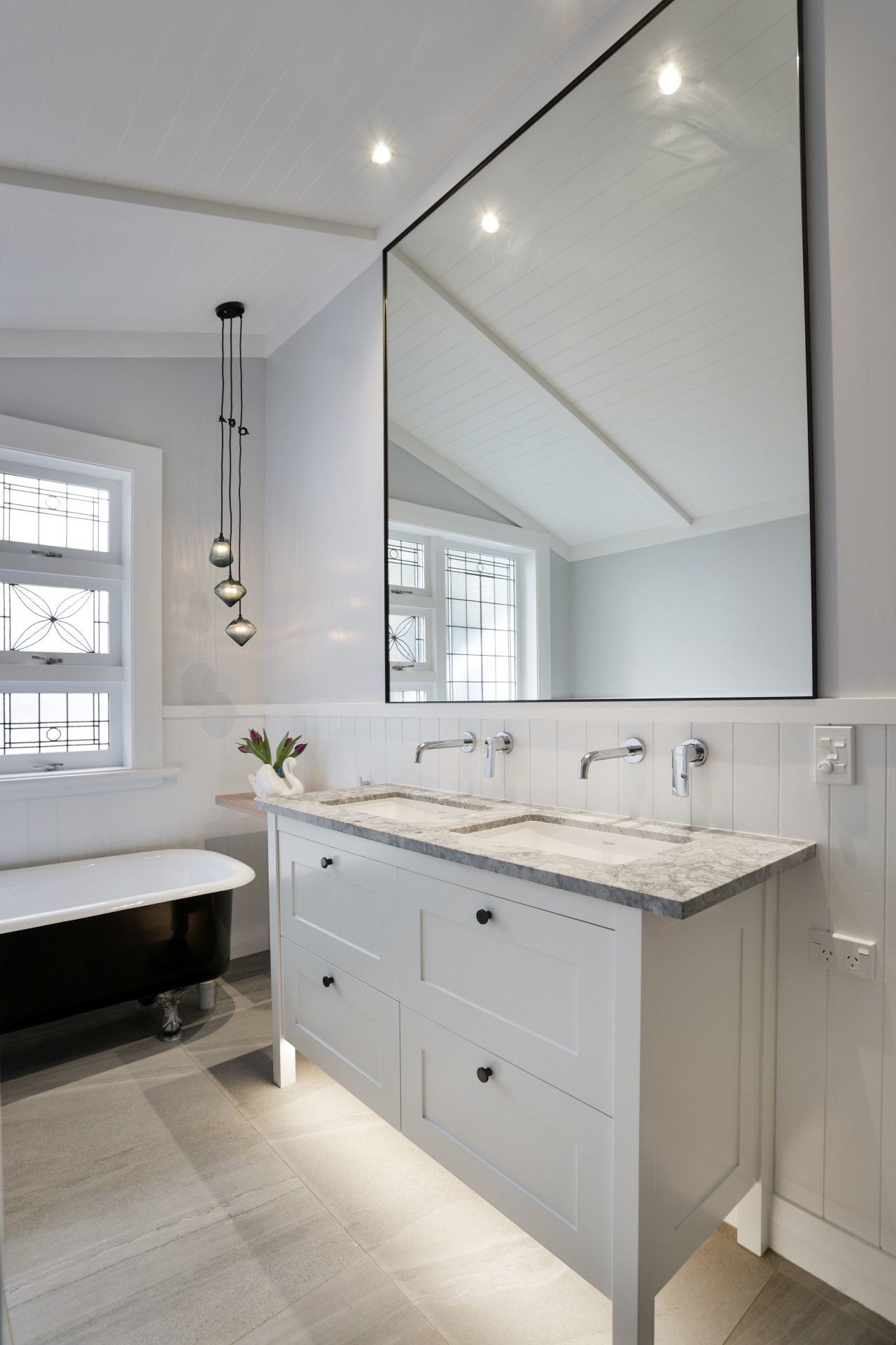 The owner had wanted a traditional look with bathroom, bathroom accessory, bathroom cabinet, cabinetry, countertop, floor, home, interior design, kitchen, room, sink, gray
