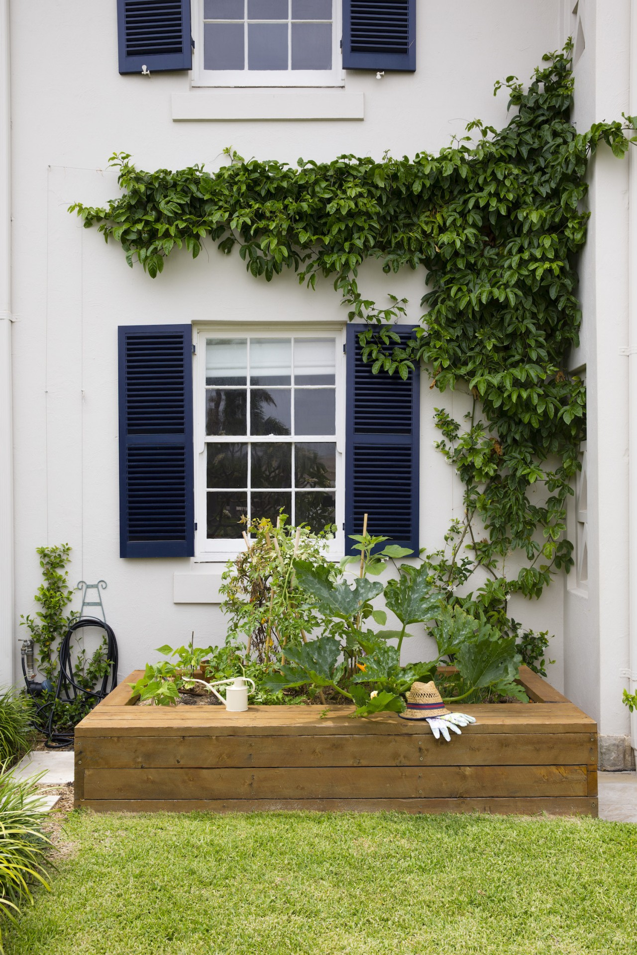 Deciding the function of your space will help backyard, courtyard, door, facade, flower, garden, home, house, outdoor structure, plant, real estate, window, yard, white, brown