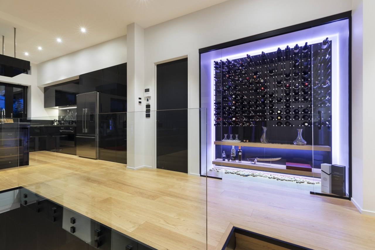 The wine cellar has a concealed glass sliding flooring, interior design, gray