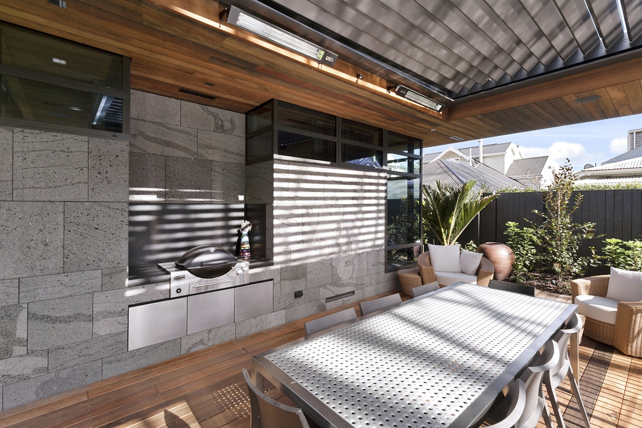 An outdoor kitchen creates a seamless indoor-outdoor flow interior design, patio, real estate, roof, window, gray
