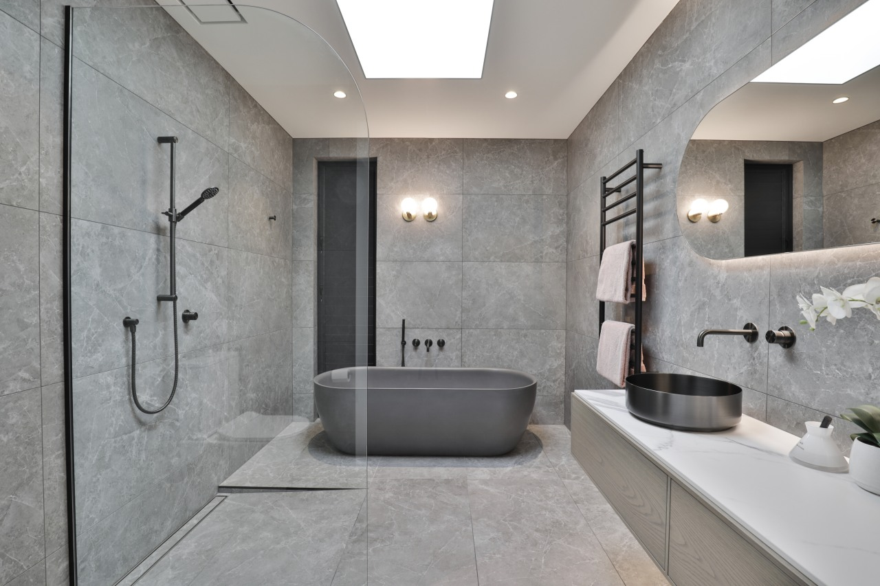 The main bathroom is a bright and fresh