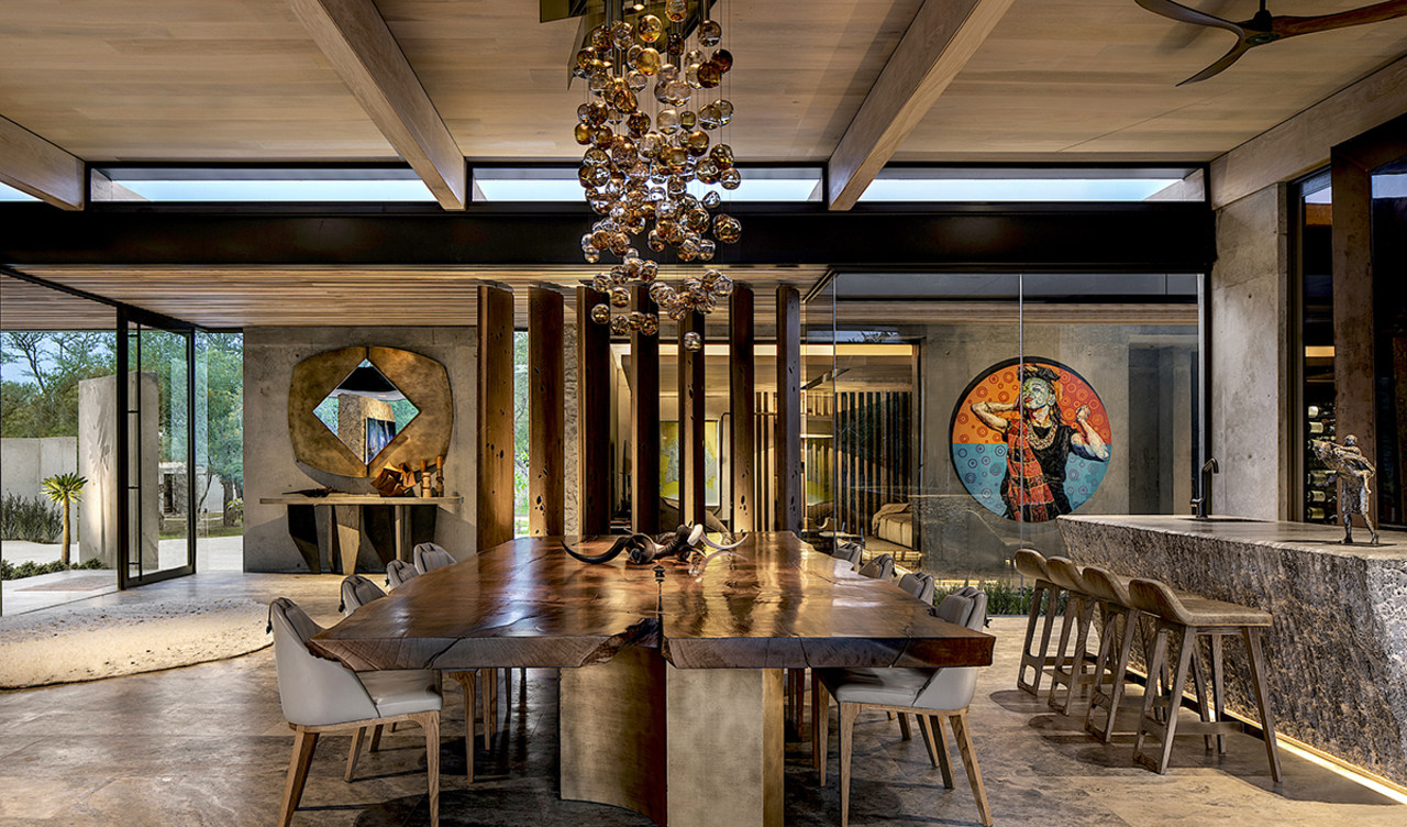 The open, seamless boundaries between interior and exterior architecture, building, ceiling, chandelier, dining room, estate, furniture, home, house, interior design, light fixture, lighting, lobby, property, real estate, room, table, brown