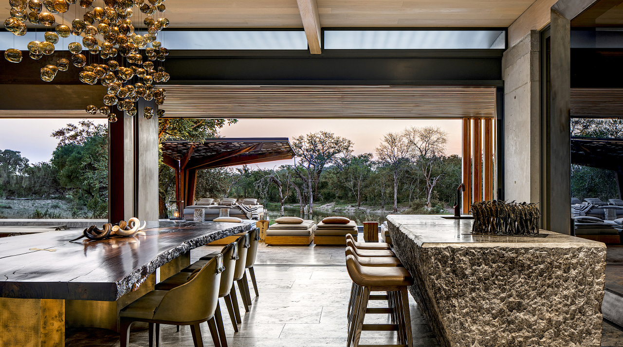 ZA Cheetah Plains Int 003 002 AL HR architecture, backyard, building, ceiling, dining room, estate, furniture, home, house, interior design, landscaping, lighting, patio, porch, property, real estate, residential area, room, shade, table, tree, black, brown, white