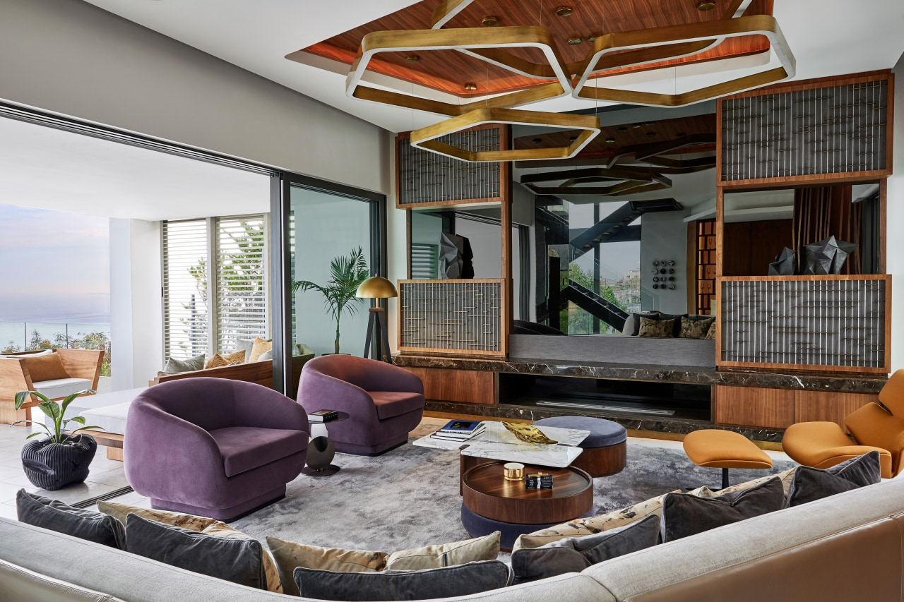 The lounge allows for complete immersion. architecture, building, ceiling, coffee table, design, furniture, home, house, interior design, living room, lobby, property, real estate, room, table, window, gray