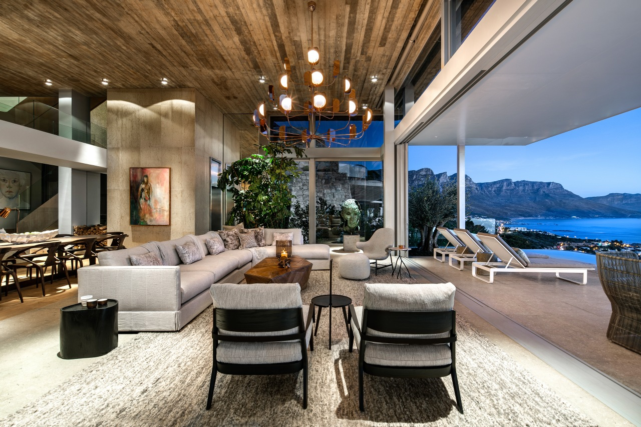 The site for this home by architects SAOTA apartment, architecture, building, ceiling, coffee table, condominium, design, estate, floor, furniture, home, house, interior design, living room, lobby, penthouse apartment, property, real estate, resort, room, sky, table, villa, brown