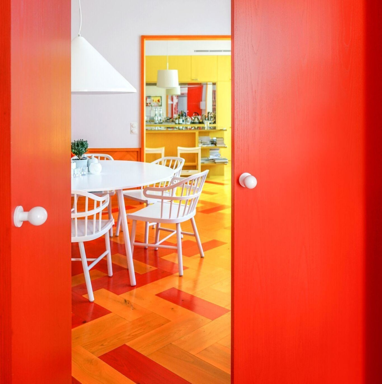 """""""The colours are addictive. Now that we know architecture, building, door, floor, furniture, house, interior design, line, material property, orange, property, red, room, table, wall, yellow, red, orange"""