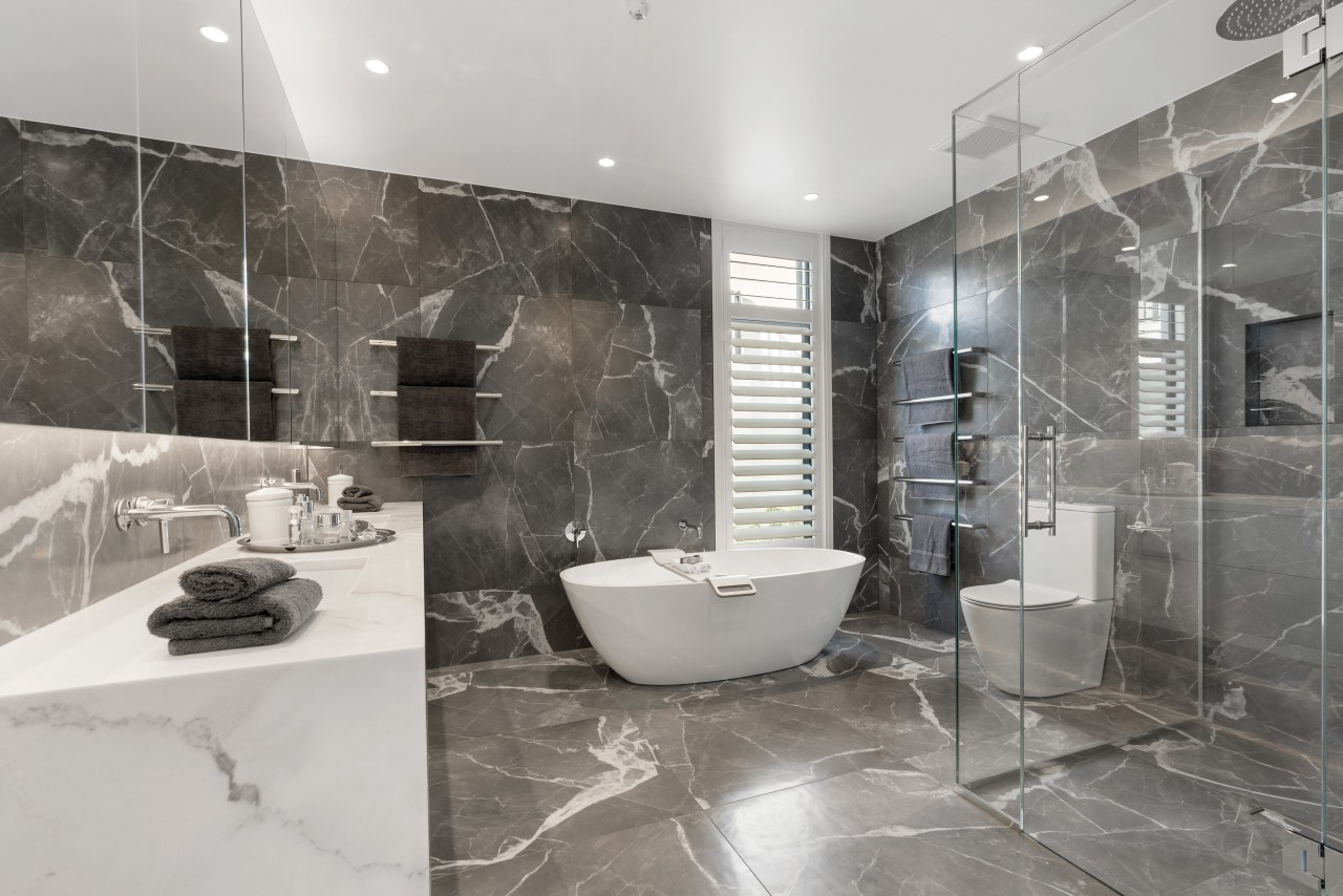 Specially sourced tiles in the main bathroom combine architecture, bathroom, bathtub, black, black-and-white, building, ceiling, floor, flooring, home, house, interior design, marble, material property, monochrome photography, plumbing fixture, property, real estate, room, tile, white, gray