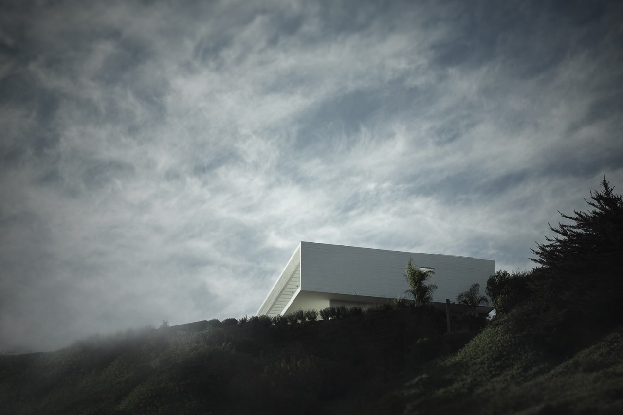 The home takes on almost ethereal form atop architecture, atmosphere, atmosphere of earth, cloud, darkness, daytime, fog, highland, hill, horizon, landscape, meteorological phenomenon, mist, morning, mountain, mountain range, observatory, phenomenon, sky, sunlight, tree, gray, black