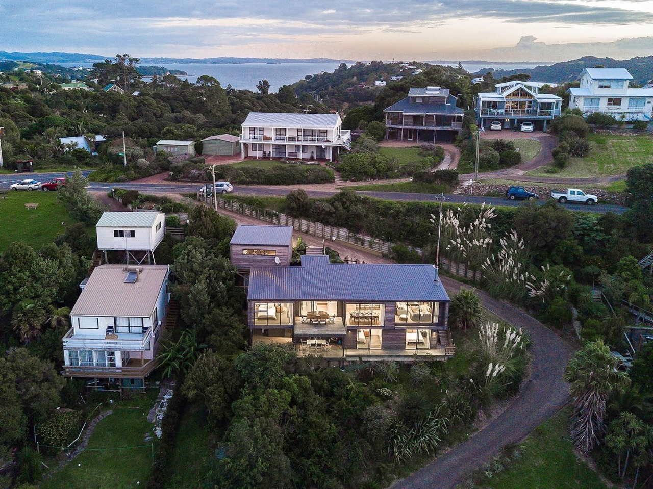 The home sits comfortably on its section aerial photography, bird's eye view, city, cottage, estate, home, house, neighbourhood, property, real estate, residential area, sky, suburb, tree, urban area, village, black