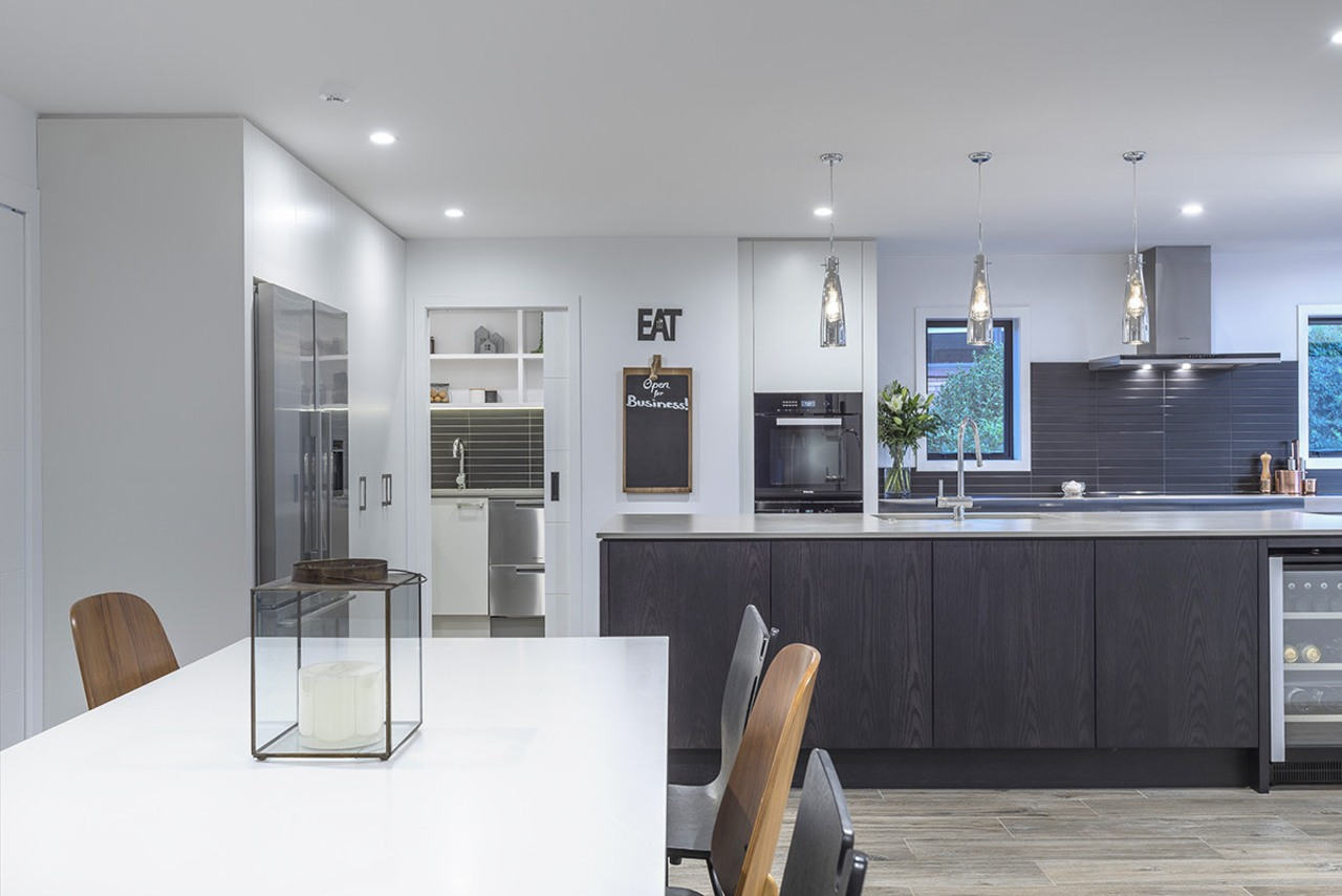 In this sleek kitchen project by designer Kira countertop, kitchen design, kitchen, Kira Gray,  Fyfe Kitchens,  concrete benchtop