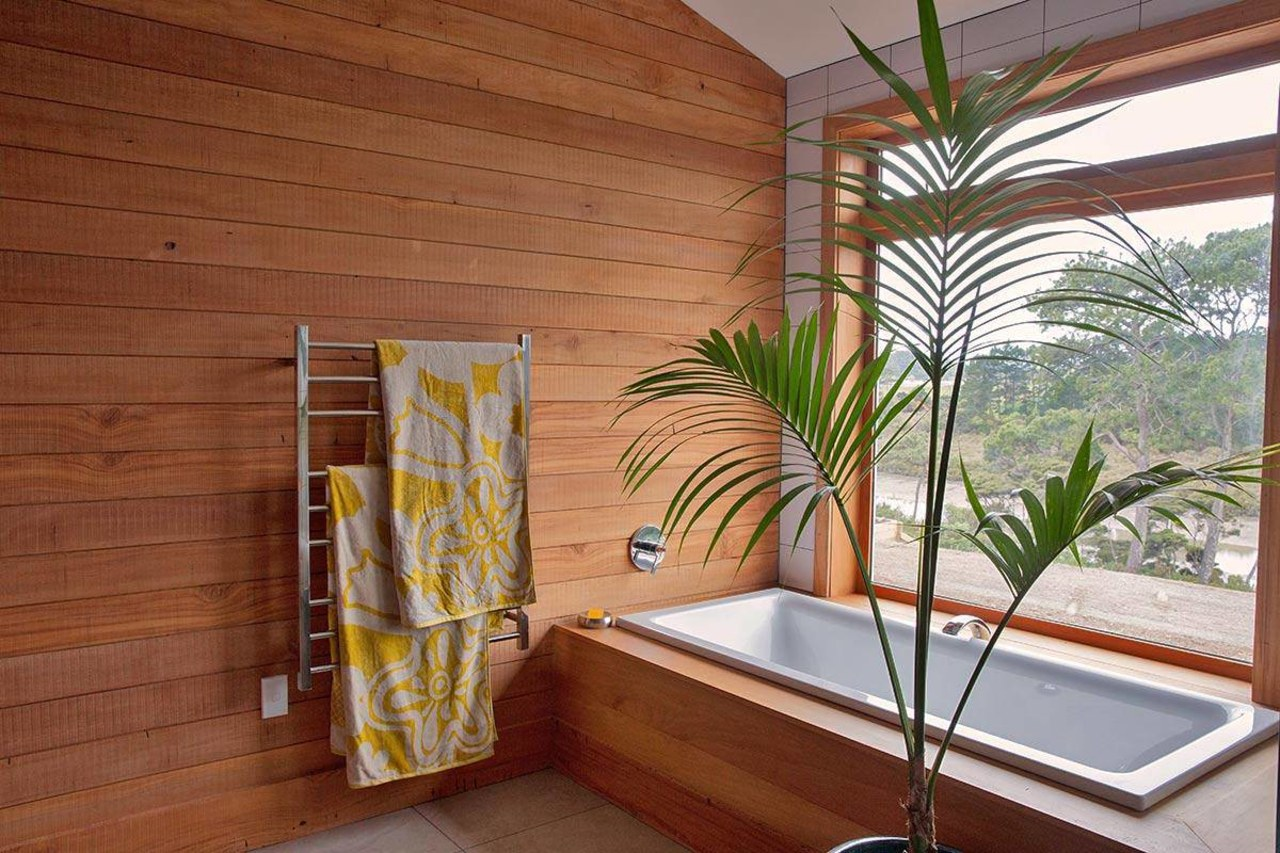 Wood is the main feature material in the architecture, ceiling, daylighting, estate, floor, home, house, interior design, property, real estate, room, wall, window, wood, brown