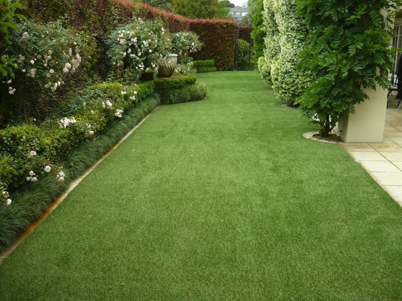 Laying high-quality artificial grasses will ensure your artificial turf, backyard, flooring, garden, grass, grass family, landscape, landscaping, lawn, plant, shrub, walkway, yard, green, brown