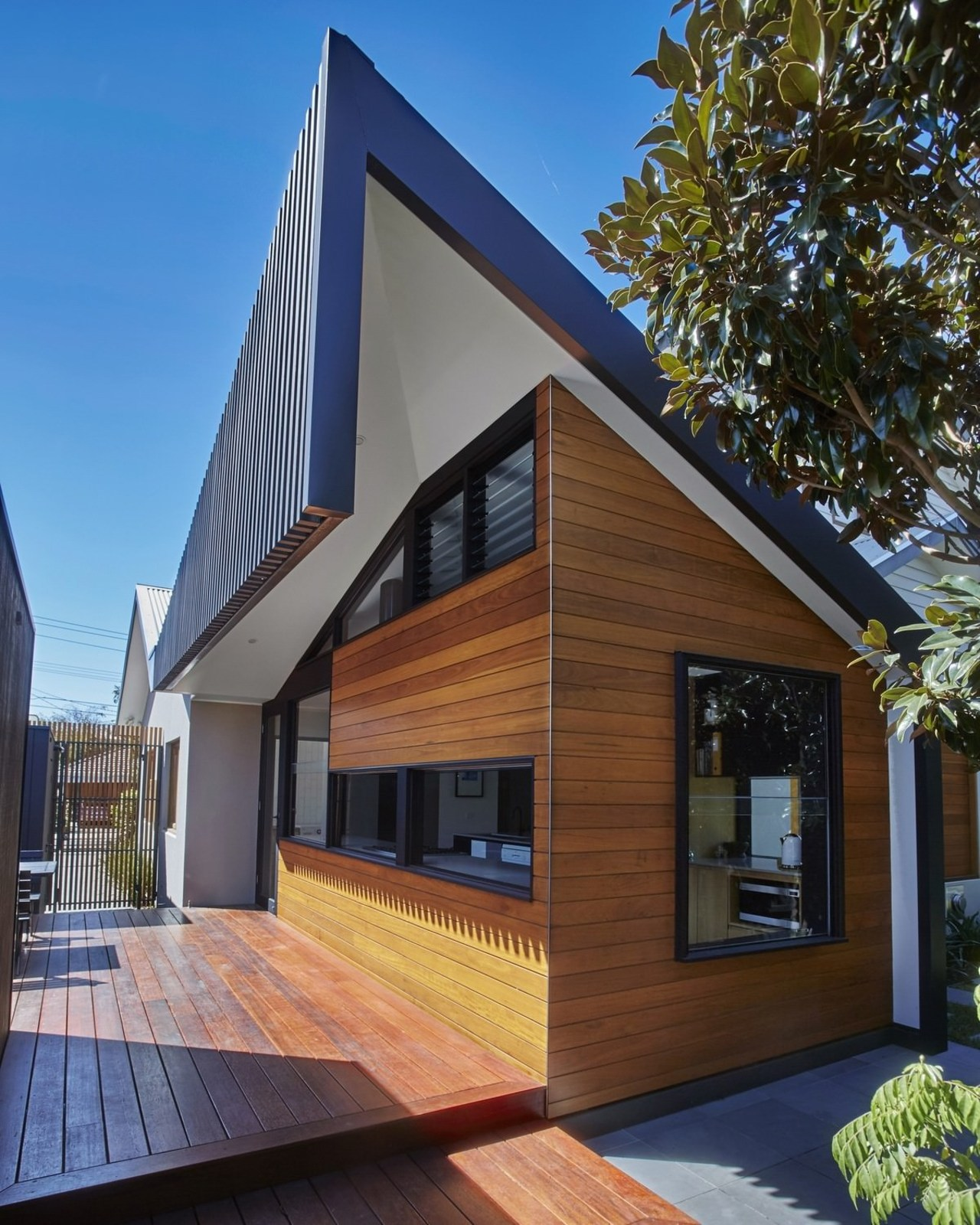 It's a clever take on the typical gable architecture, building, elevation, facade, home, house, property, real estate, residential area, siding, window, brown