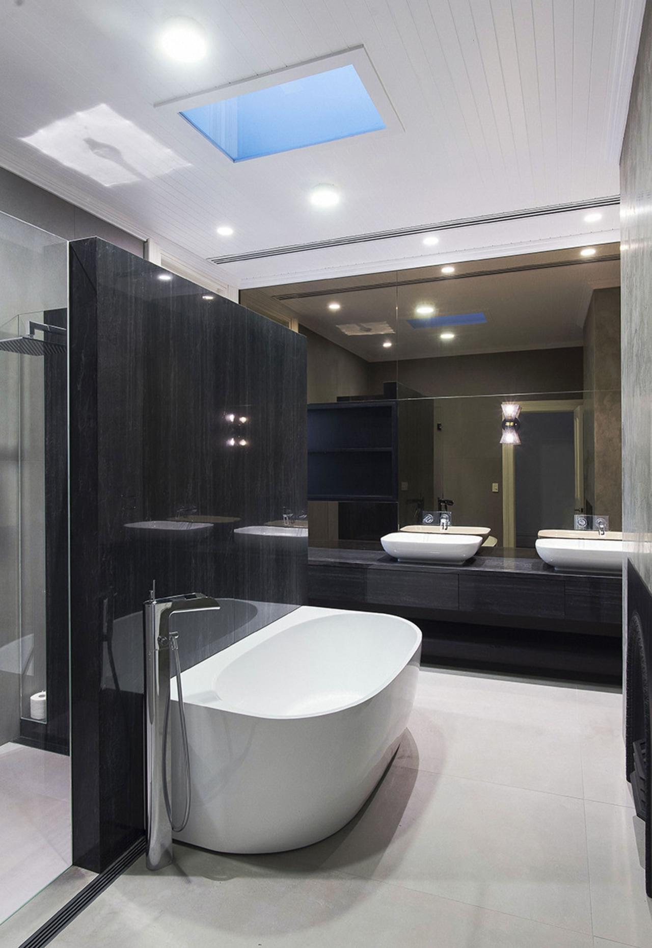This home's main bathroom – in the original bathroom, floor, interior design, plumbing fixture, room, sink, gray, black, skylight
