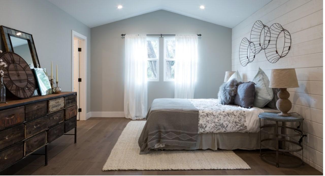 A view of the bedroom from the far bed frame, bedroom, ceiling, floor, flooring, home, interior design, real estate, room, wall, window, wood, gray