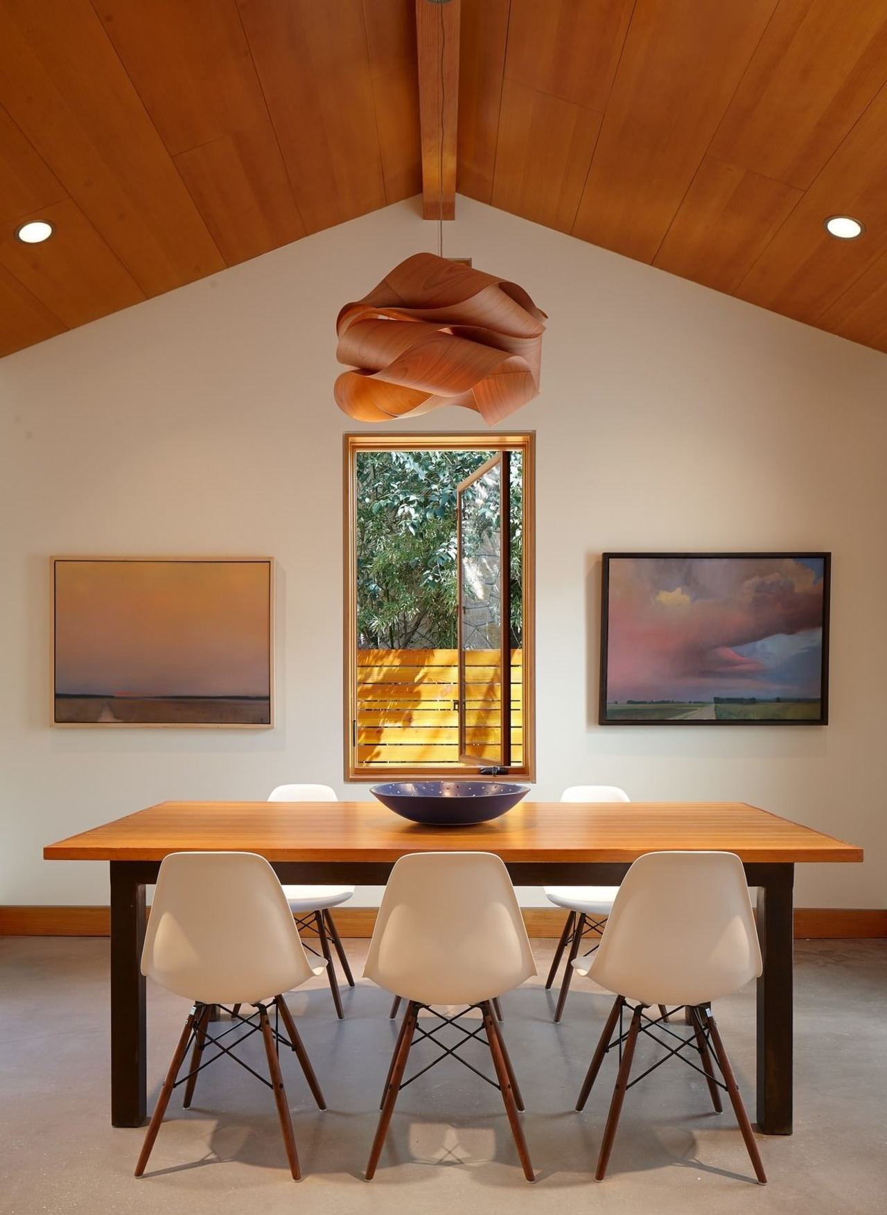 The chandelier makes for an interesting focal point. architecture, ceiling, chair, dining room, furniture, home, house, interior design, light fixture, table, brown