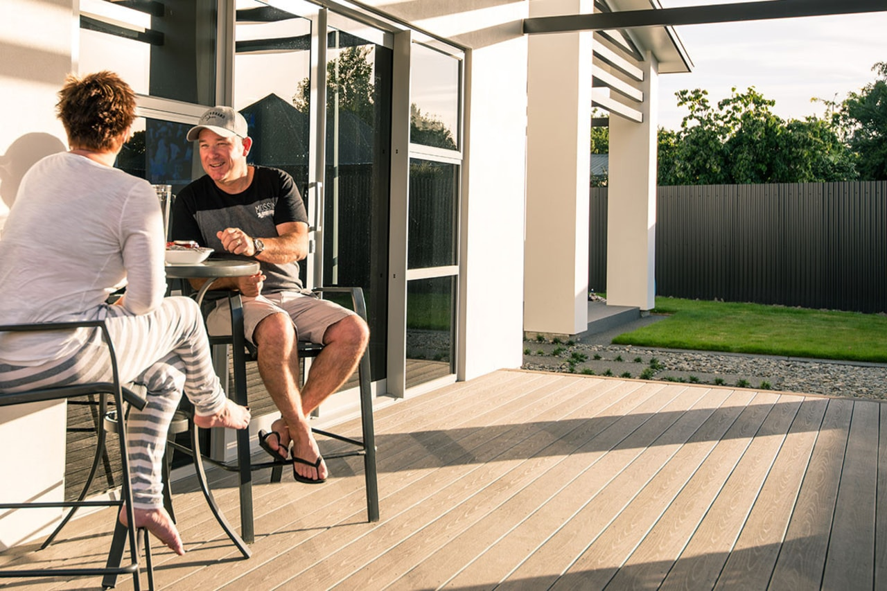 Relaxing on a TimberTech deck from Niagara deck, floor, flooring, home, house, outdoor structure, window, wood, white