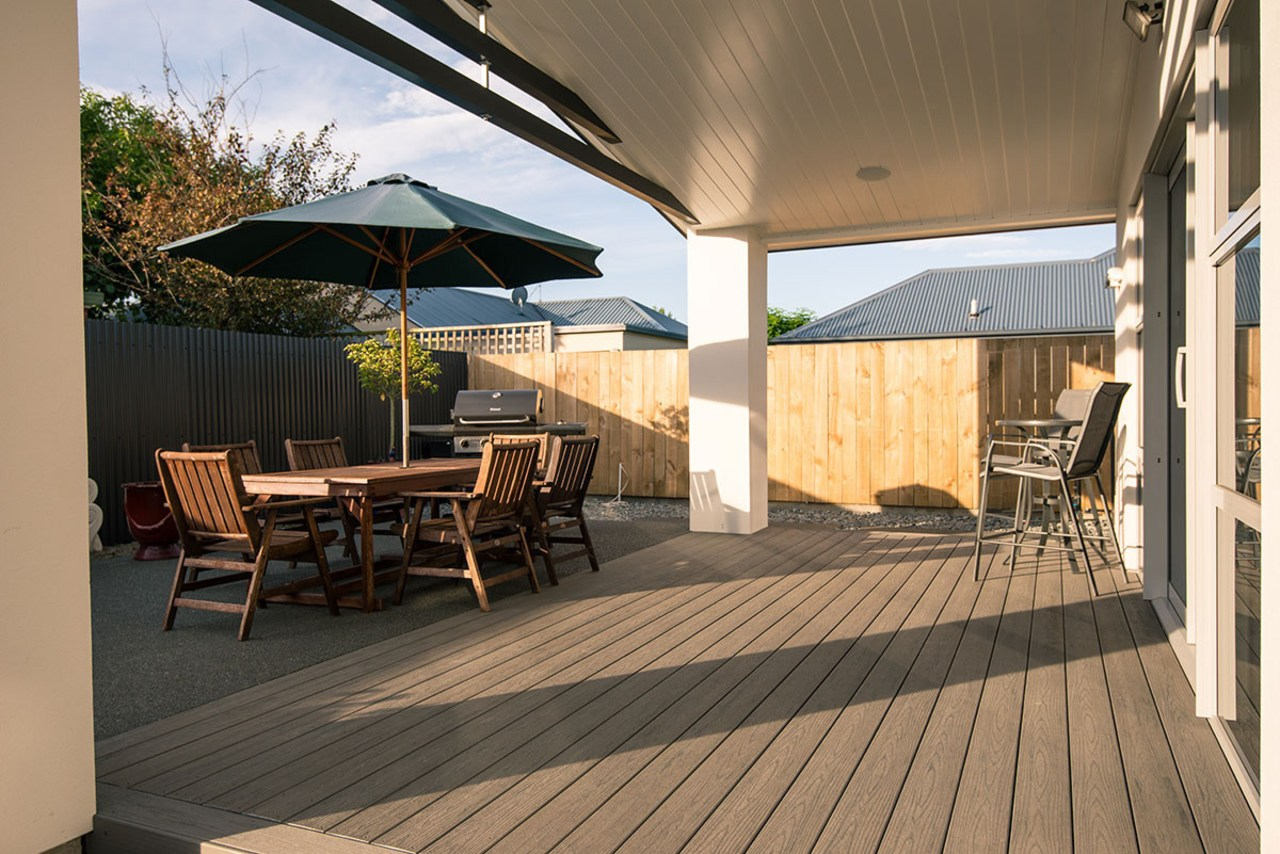 All set for dining on a TimberTech composite deck, floor, flooring, outdoor structure, patio, property, real estate, roof, shade, brown