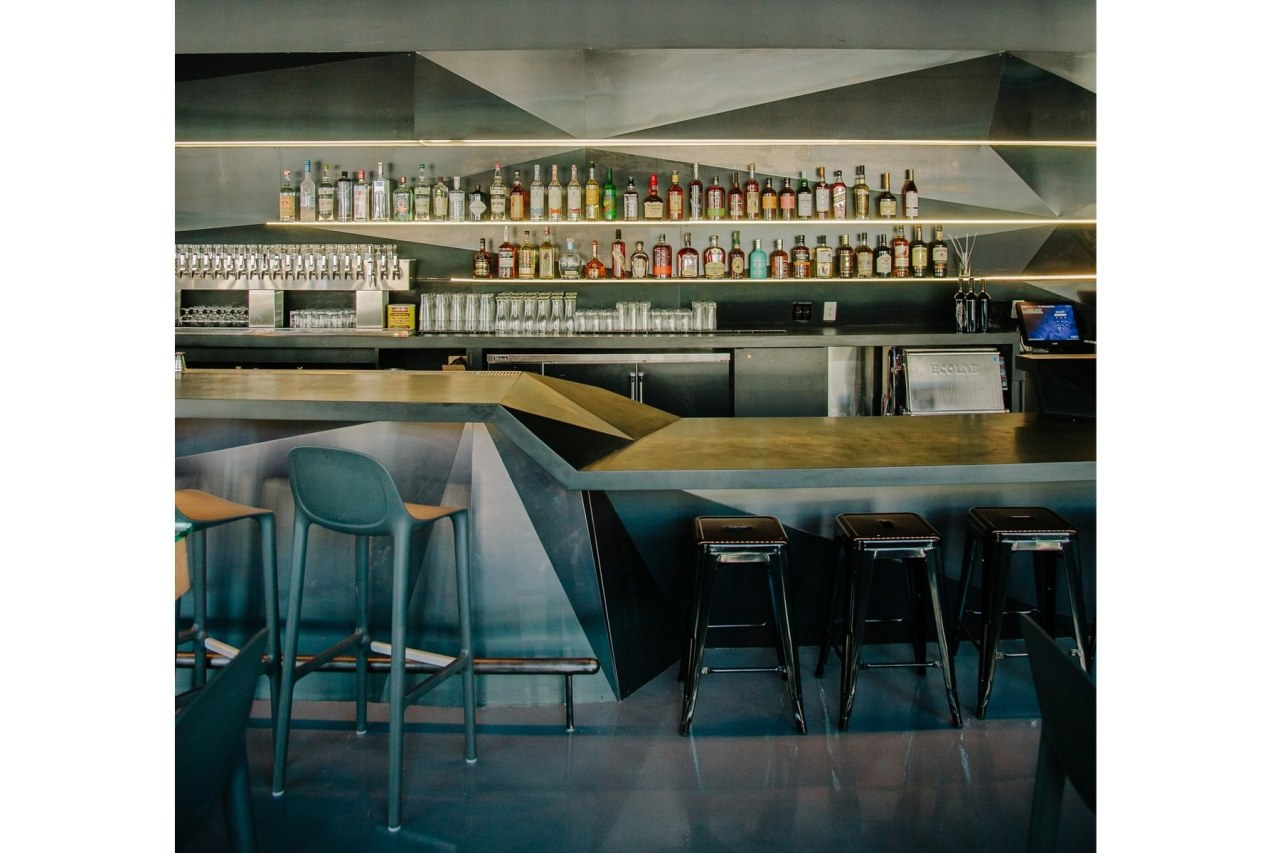 A wider view of the bar area furniture, interior design, table, black, white