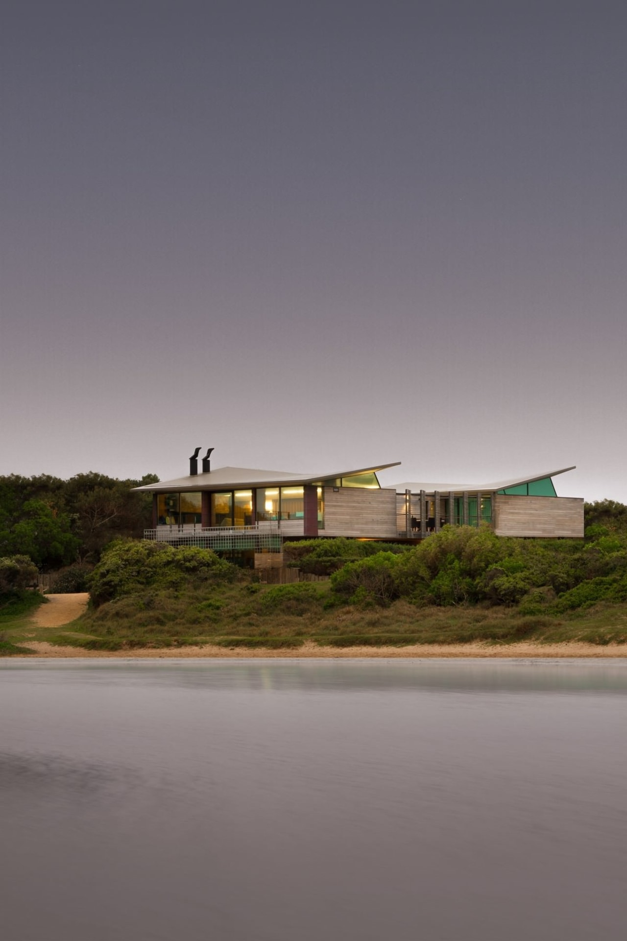 A view of the home from the water architecture, cloud, house, landscape, reflection, sky, water, gray