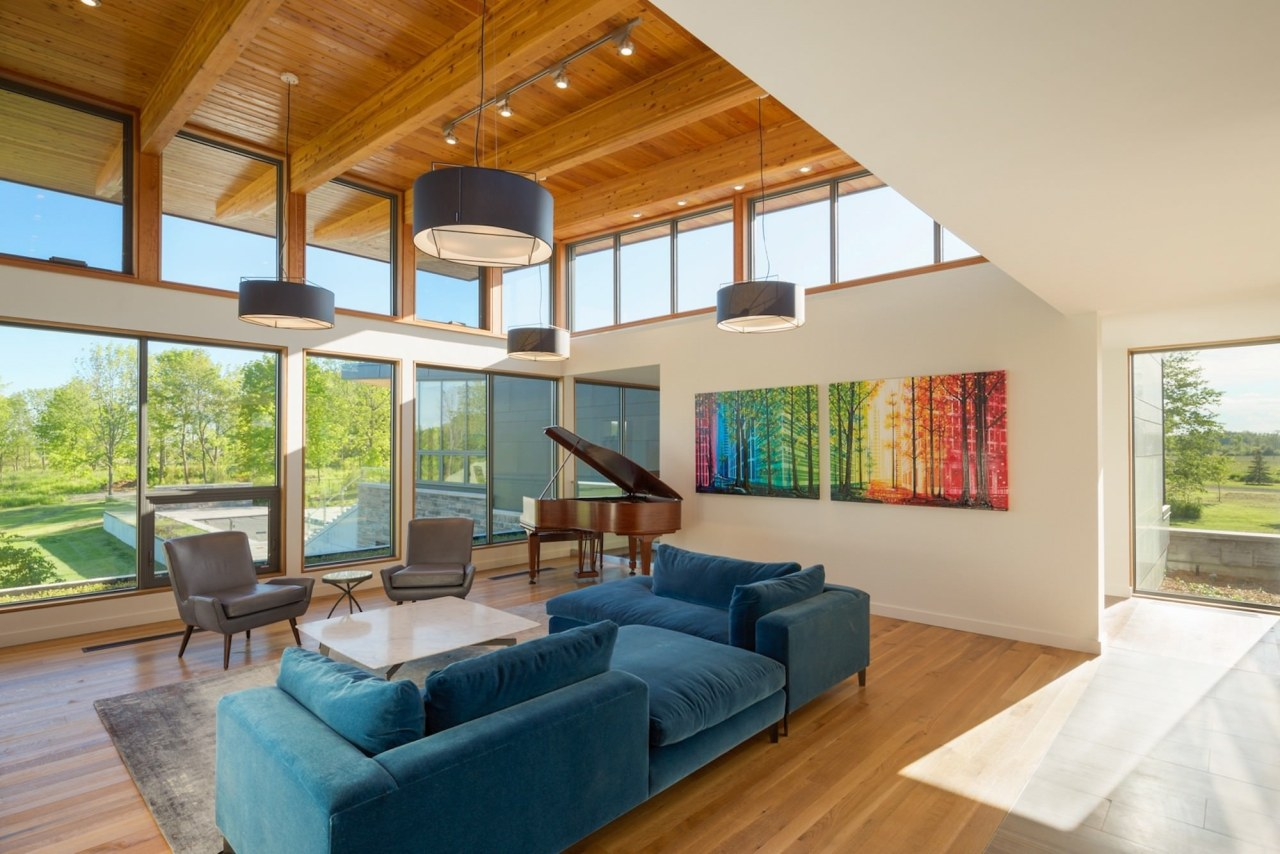 Another view of the living room architecture, ceiling, daylighting, estate, hardwood, home, house, interior design, living room, property, real estate, window, wood, orange