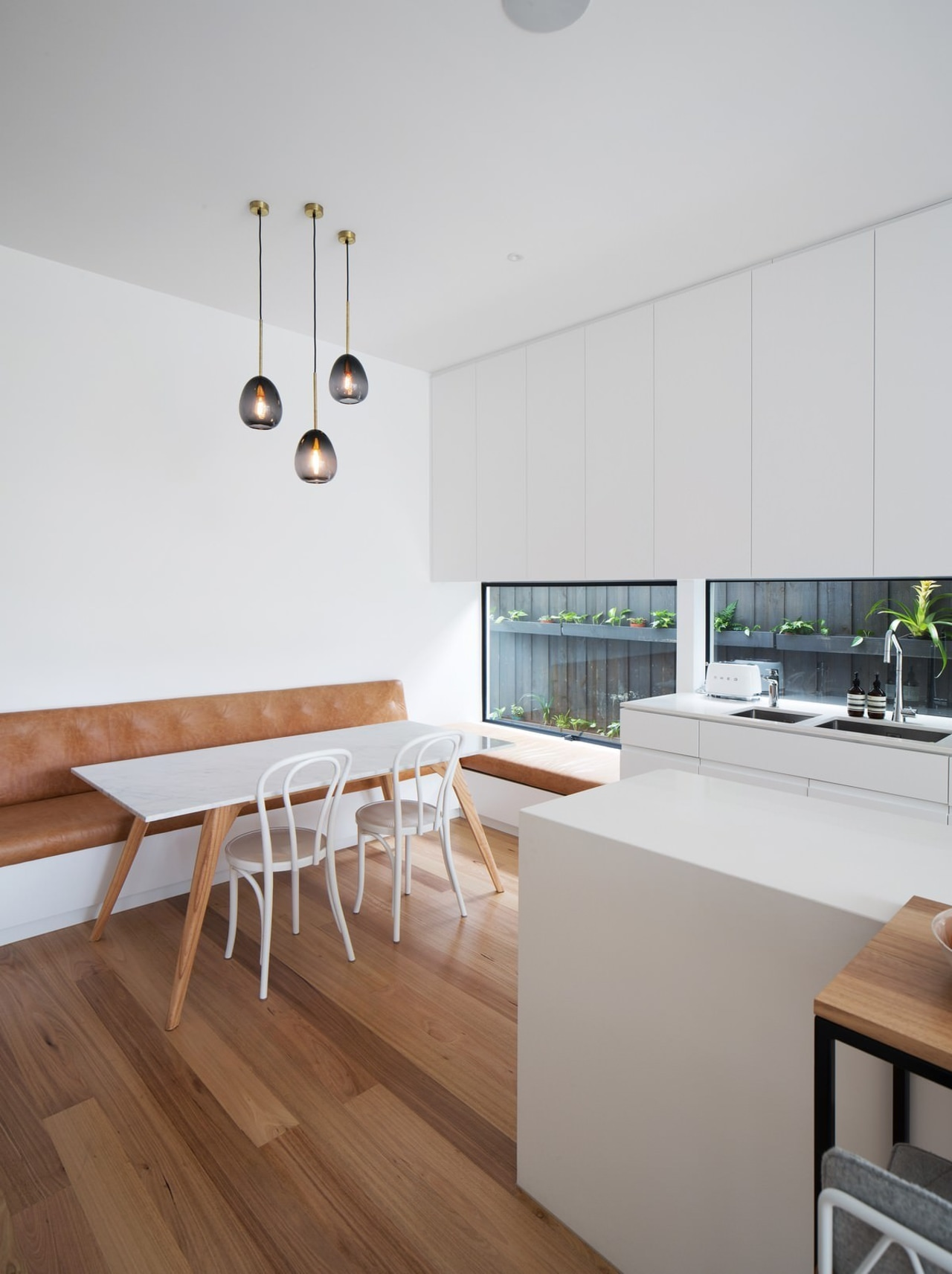 This dining area is ideal for a young floor, house, interior design, kitchen, product design, table, white, gray