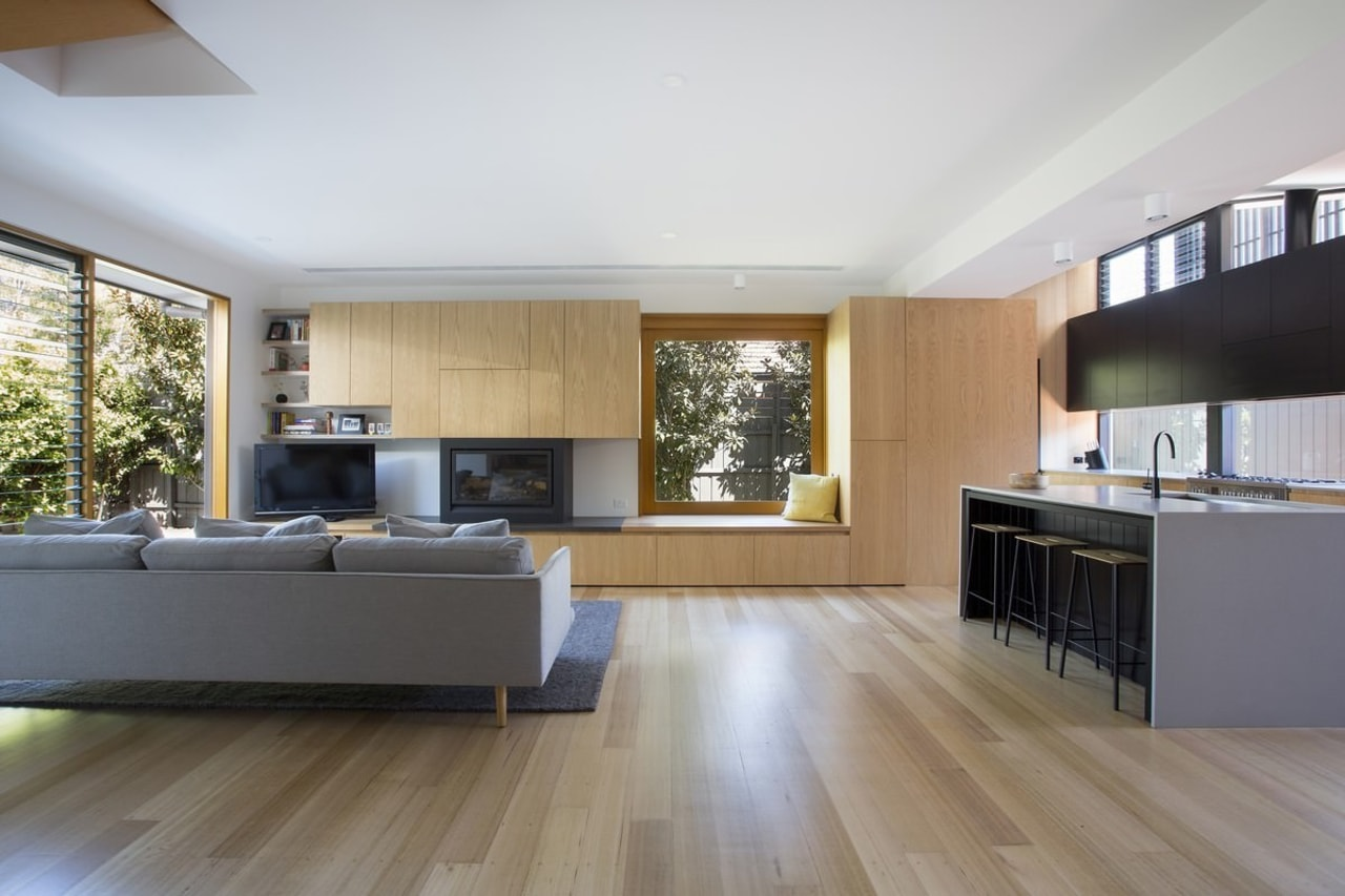 The lounge flows into the kitchen. The window architecture, floor, flooring, hardwood, house, interior design, kitchen, laminate flooring, living room, room, wood, wood flooring, gray