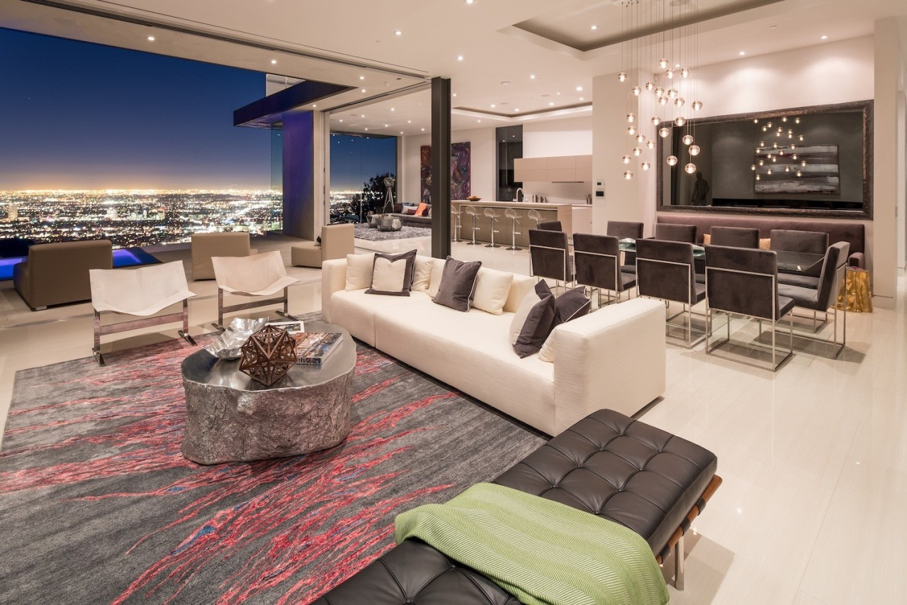 The home opens up to the city floor, flooring, home, interior design, living room, penthouse apartment, property, real estate, orange