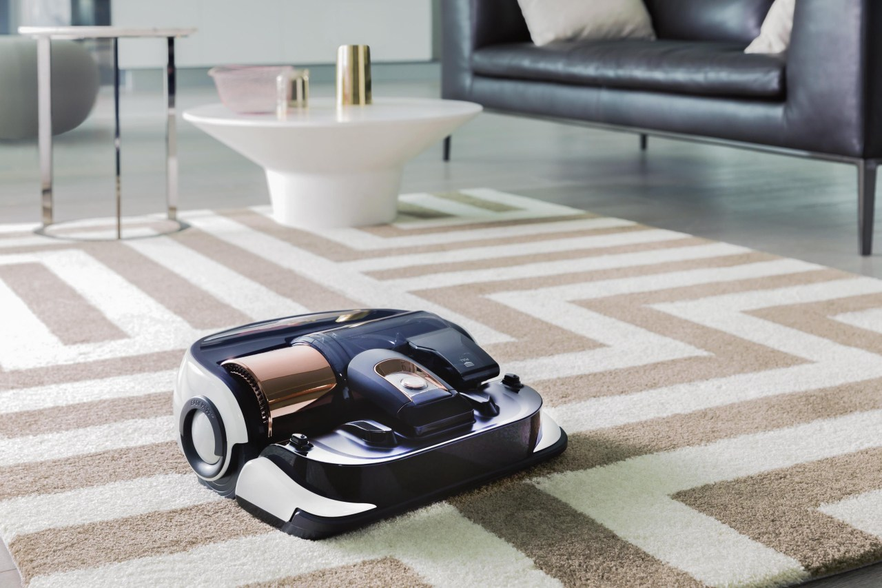 The Powerbot Robot Vacuum VR9000 by CycloneForce™ automotive design, floor, flooring, furniture, product, table, gray