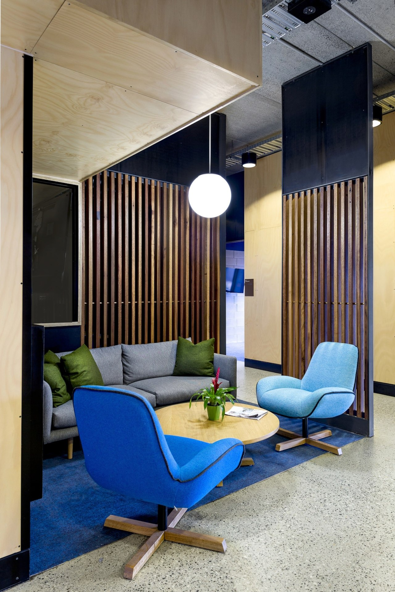 Impromptu meeting areas make this building perfect for architecture, ceiling, chair, furniture, house, interior design, living room, lobby, gray