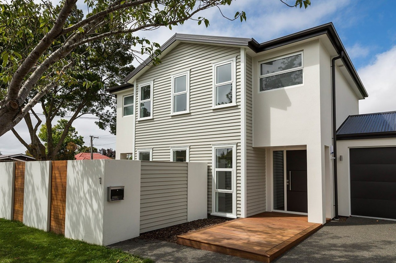 A stylish house by R.E.B Builders NZ - building, elevation, facade, home, house, property, real estate, residential area, siding, window, gray, white