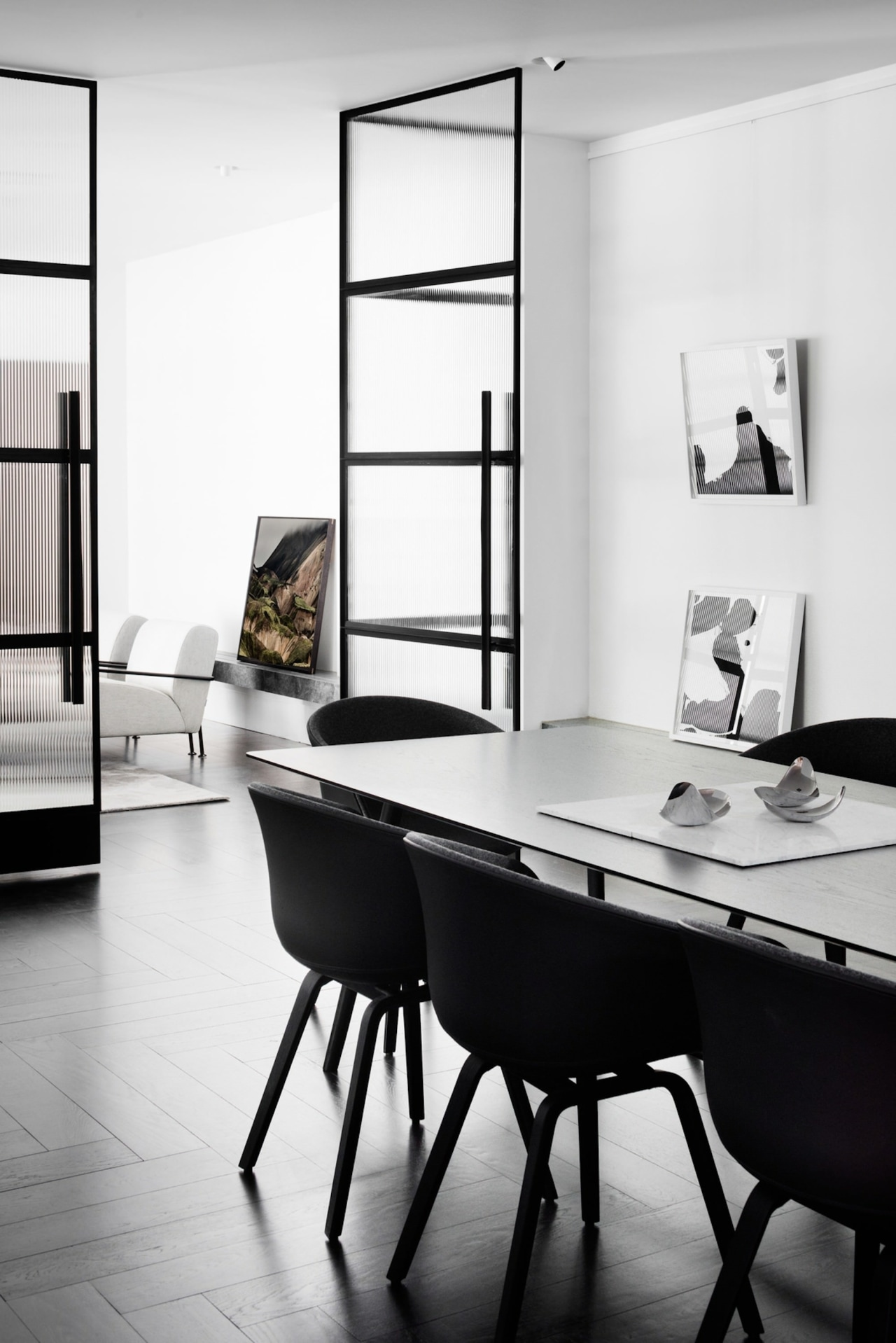 The dining area with angled mirrors black and white, chair, furniture, interior design, product design, shelf, shelving, table, white