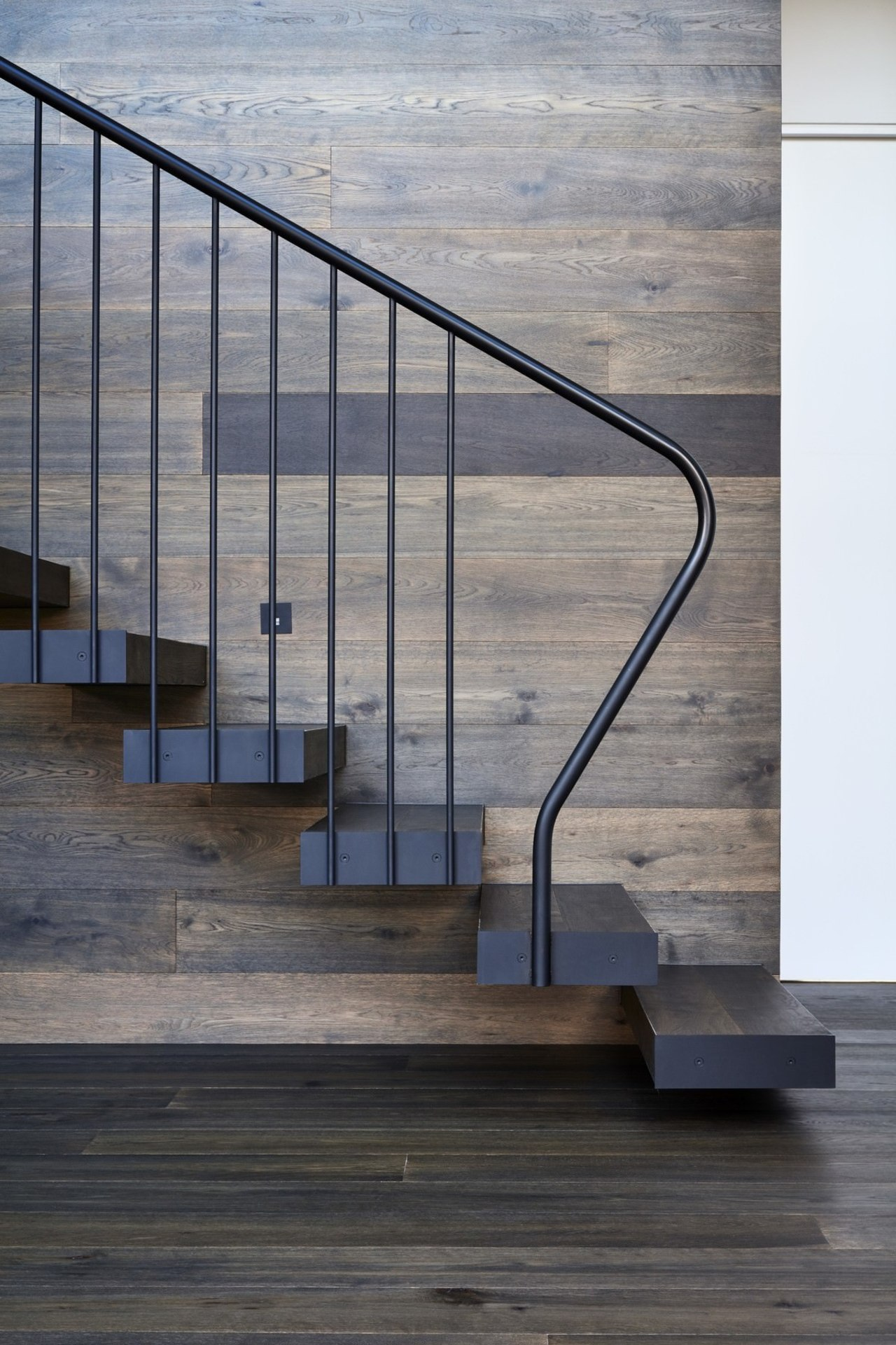 A metal balustrade holds up the staircase architecture, glass, handrail, iron, stairs, gray, black