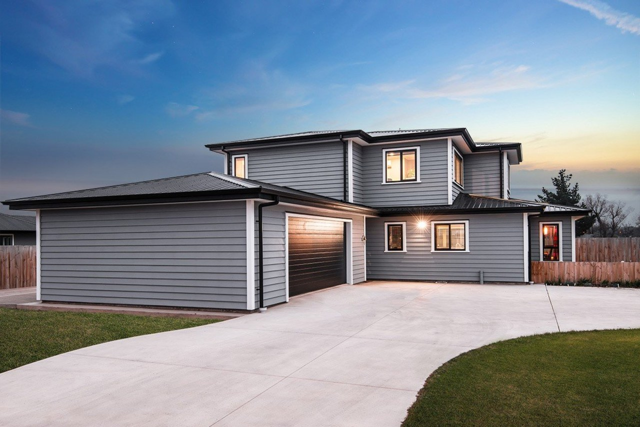 A new home clad with Envira Weatherboard System building, elevation, estate, facade, home, house, property, real estate, residential area, siding, sky, white