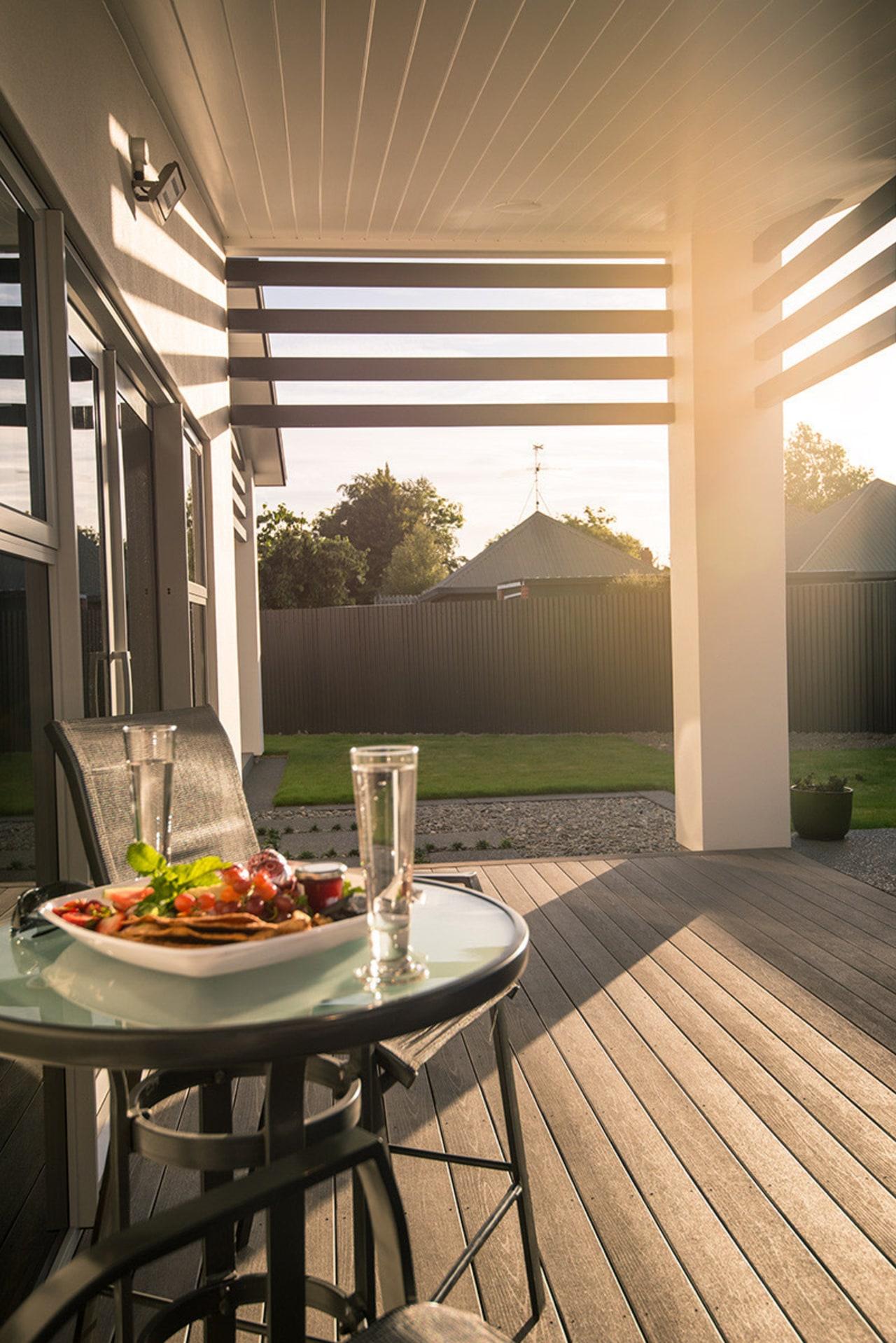 Evening on a TimberTech Terrain deck backyard, deck, home, house, interior design, outdoor structure, patio, porch, real estate, table, window, brown, orange