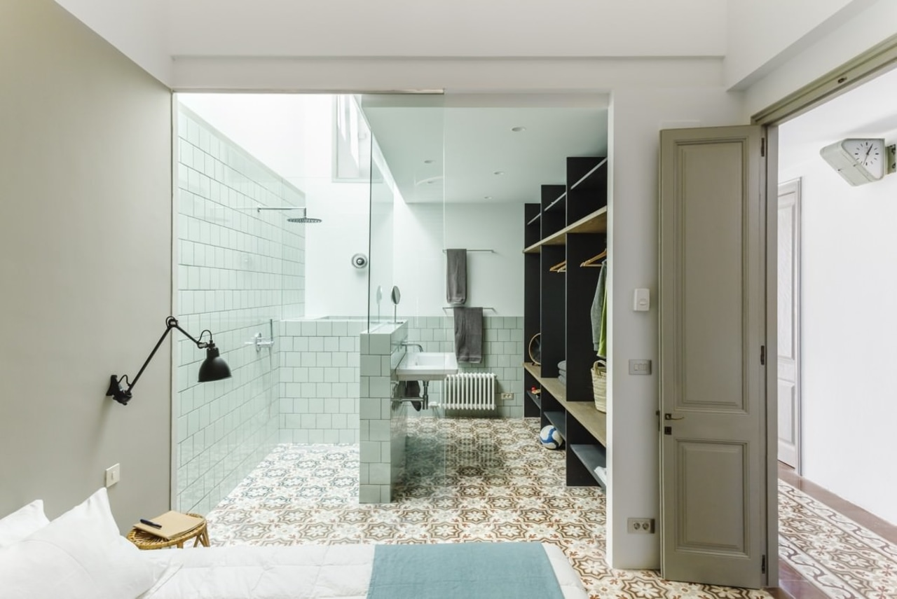 This open bathroom features tiles from the kitchen, architecture, bathroom, floor, home, house, interior design, property, real estate, room, gray, white
