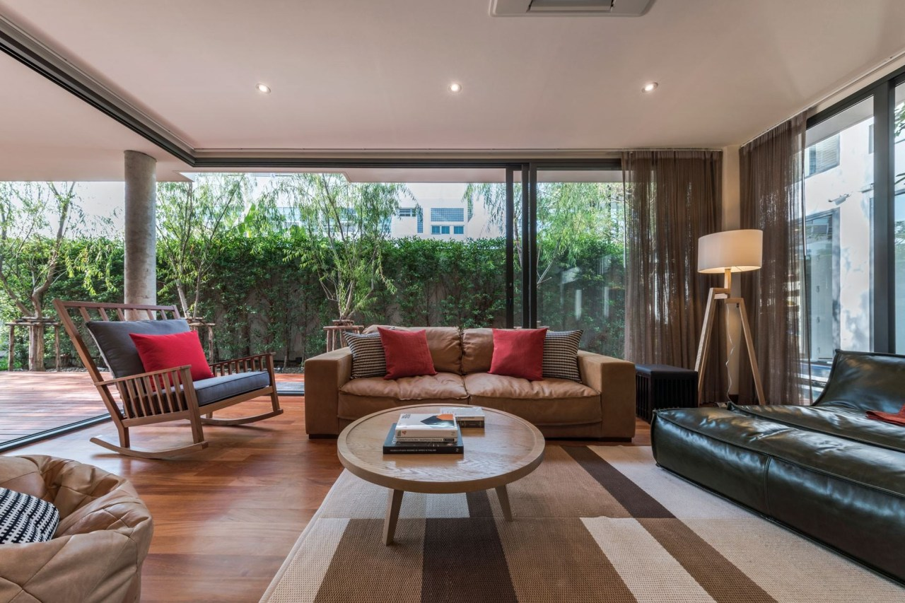 The glass sliding doors are a welcome sight estate, house, interior design, living room, property, real estate, window, gray