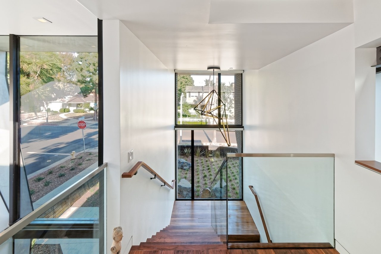 A glass balustrade ensures clean sight lines through architecture, daylighting, door, floor, handrail, home, house, interior design, property, real estate, window, gray