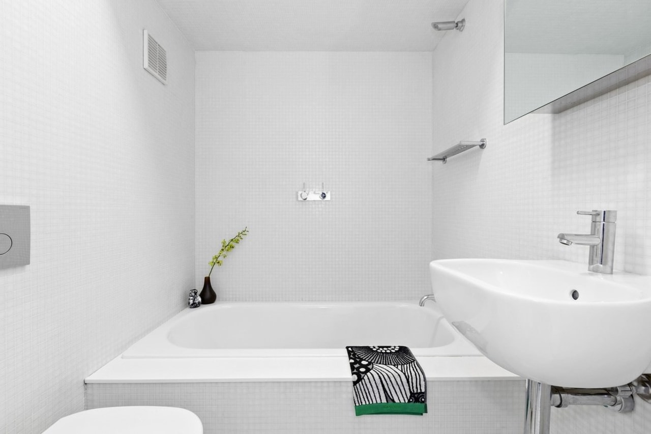 A large bathtub dominates the bathroom architecture, bathroom, bathroom sink, bidet, black and white, floor, house, interior design, plumbing fixture, product design, property, room, tap, tile, wall, white