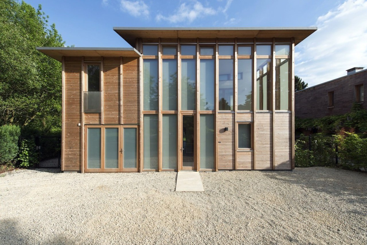 Glass runs from the ground floor up to architecture, facade, home, house, property, real estate, shed, white